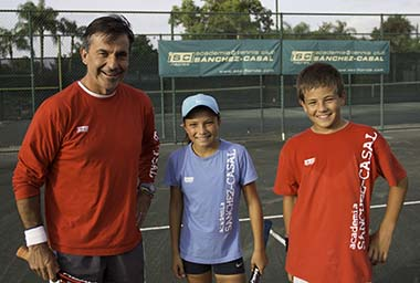 Emilio Sánchez with two of his students at Academia Sánchez-Casal, Naples, Florida