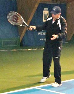 Roy Emerson demostrating a forehand