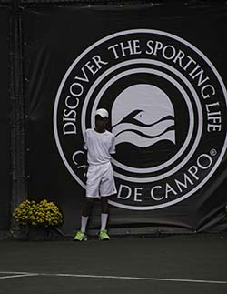 On the job: One of Casa de Campo's stable of ball boys